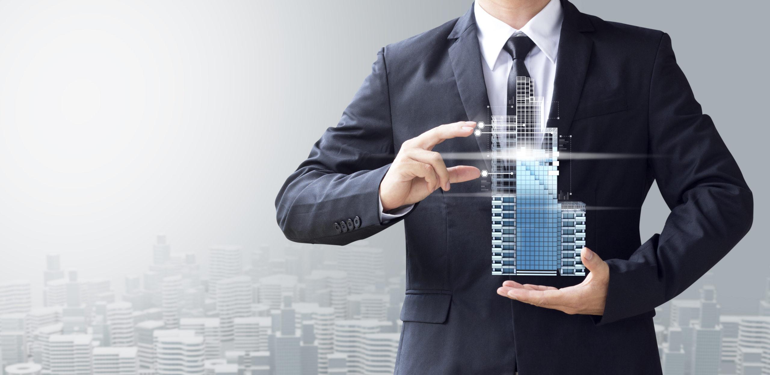 business man create design modern building. Инвестиции в недвижимость